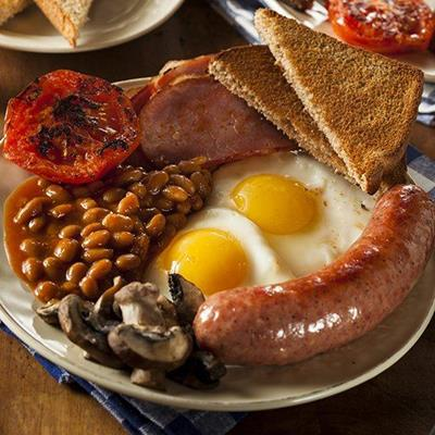 BAKEDBEANS, BACON, MUSHROOMS, TOAST, SAUSAGE, BREAKFAST, EGGS, TOMATO, PLATE, UTENSILS