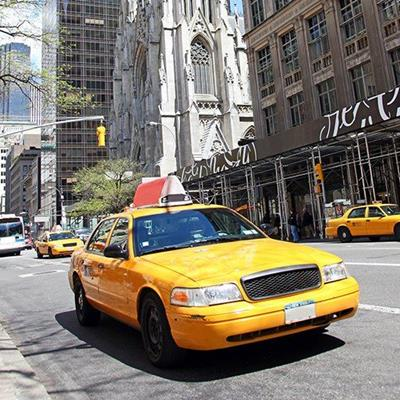CAB, LIGHTS, PASSENGER, DRIVER, STREET, TAXI, YELLOW, FARE, BUILDINGS, TREE, SIGNS, CITY