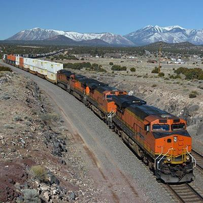 TRAIN, DIESEL, ROCKS, RAILS, ORANGE, LOCOMOTIVE, SHRUBS, DESERT, ENGINE, WAGON