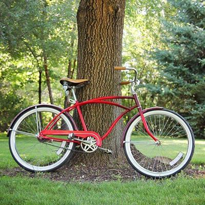 BICYCLE, FRAME, TREE, PEDALS, SPOKES, WHEELS, HANDLEBARS, SADDLE, CHAIN, BRAKES