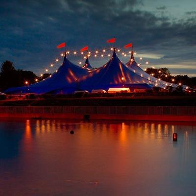 CIRCUS, BIGTOP, LIGHTS, ACROBAT, TENTS, RINGMASTER, REFLECTION, CLOWN, FLAGS