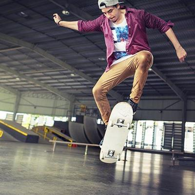 SKATEBOARD, RAMPS, BASEBALLCAP, RAIL, TRICK, WHEELS, DECK, SHIRT, ROOF, POSE