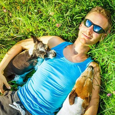 SUNBATHING, RELAXED, DOGS, SUNGLASSES, VEST, SMILE, MEADOW, CANINE, PETS, ARMS
