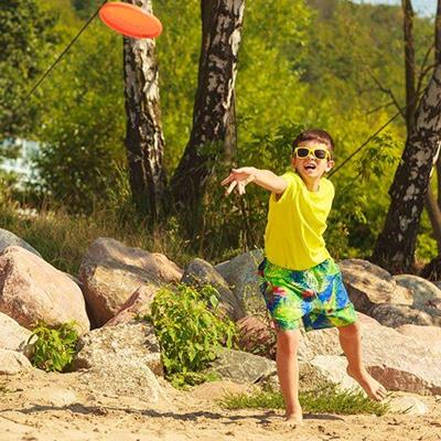 THROW, DISC, BOY, SUNGLASSES, OUTDOOR, ACTIVITY, BAREFOOT, FRISBEE, SHORTS, ROCKS