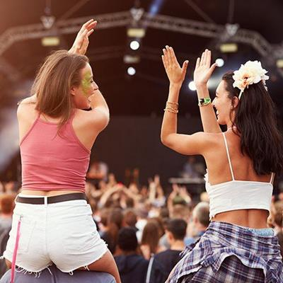 CONCERT, FESTIVAL, STAGE, WOMEN, OUTDOOR, MUSIC, AUDIENCE, PERFORMANCE, GARLAND