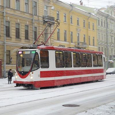 STREETCAR, RAILS, WIRES, CITY, STOP, PASSENGERS, SNOW, ELECTRICITY, TRAFFIC