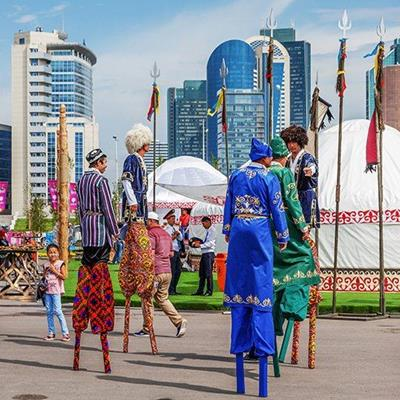COSTUMES, TRIDENT, FLAGS, SILK, FESTIVAL, FURHAT, STILTS, TRADITIONAL, CEREMONY, BUILDINGS, TENTS