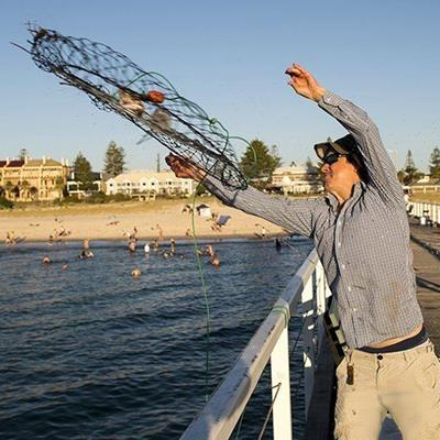 NET, CASTING, SWIMMERS, RAILING, BEACH, ROPE, FISHING, PIER, SUNGLASSES, THROW, SAND, SHORE