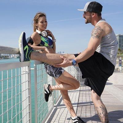STRETCH, SHORTS, FITNESS, TATTOOS, HANDRAIL, CAP, WATCH, FENCE, SMILES, BOARDWALK, SPORTSWEAR