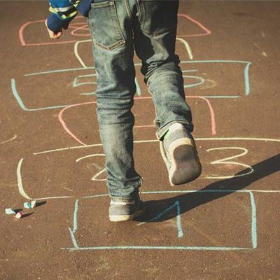 HOPSCOTCH, CHALK, GAME, NUMBERS, FIVE, THREE, ONE, YELLOW, SHADOW, JEANS, EIGHT, PINK, BLUE