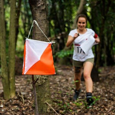 CHECKPOINT, FLAG, STRING, SHORTS, LEAVES, RACE, COMPETITOR, NUMBER, TATTOO, WOODS, FOREST, TREES